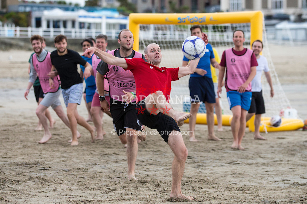 DINARD, FRANCE - Tuesday, June 28, 2016: FAW staff members and journalists covering Wales have a game of beach football on Plage de l' Ecluse beach, Dinard ahead of the Quarter-Final match Wales against Belgium during the UEFA Euro 2016 Championship. Rhodri Llywelyn. (Pic by Paul Greenwood/Propaganda)