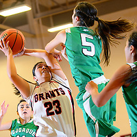 121413  Adron Gardner/Independent<br /> <br /> Grants Pirate Dominique Lowden (23), left,  attempts a shot under Pojoaque Elkette Aaliya Casados (5) during the Eddie Peña Classic Basketball Tournament in Grants Saturday.