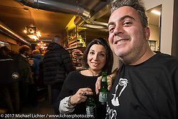 Mr Martini's party at his downtown shop - restaurant after the first day of Motor Bike Expo. Verona, Italy. Friday January 20, 2017. Photography ©2017 Michael Lichter.