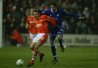 Fotball<br /> England 2004/22005<br /> Foto: SBI/Digitalsport<br /> NORWAY ONLY<br /> <br /> Blackpool v Leicester City<br /> FA Cup Third Round Replay. 18/01/2005. <br /> <br /> Keith Southern of Blackpool holds off Gareth Williams of Leicester City.