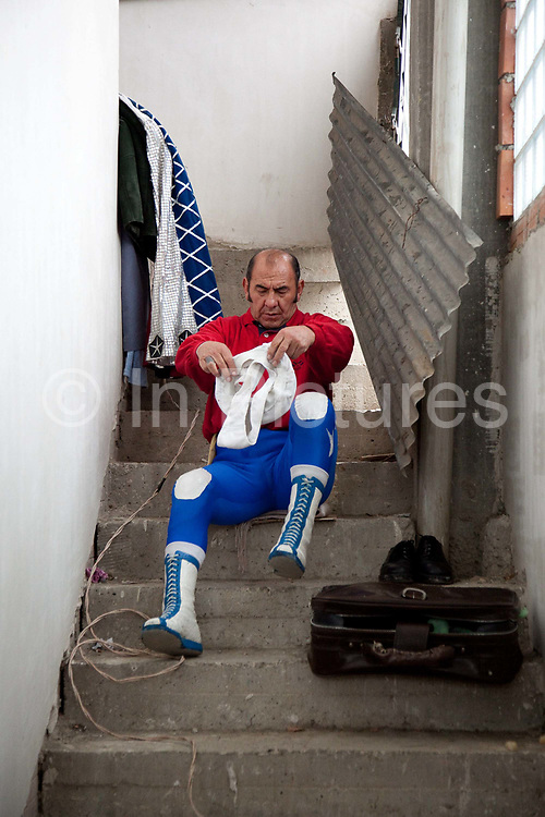 Male fighter getting ready dressed for the show. Lucha Libre wrestling origniated in Mexico, but is popular in other latin Amercian countries, including in La Paz / El Alto, Bolivia. Male and female fighters participate in the theatrical staged fights to an adoring crowd of locals and foreigners alike.