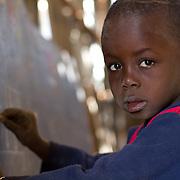 A brave boy steps up to show his Koumbadiouma classmates what he's learned. Kolda, Senegal.