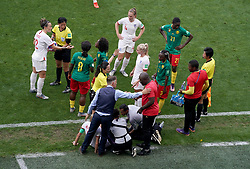 Match referee Qin Liang (second left) intervenes after Cameroon's Alexandra Takounda (21) fouls England's Steph Houghton (obscured) and England head coach Phil Neville (bottom left) and Cameroon head coach Alain Djeumfa (bottom right) exchange words during the FIFA Women's World Cup, round of Sixteen match at State du Hainaut, Valenciennes.