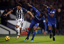 West Bromwich Albion's Matt Phillips (left) battles for the ball with Everton's Cuco Martina (centre) and Yannick Bolasie (right) during the Premier League match at The Hawthorns, West Bromwich.