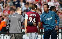 Photo: Paul Greenwood.<br />Sheffield United v West Ham United. The Barclays Premiership. 14/04/2007.<br />West Ham manager Alan Curbishley, (R) consoles a distraught Mark Noble at the end of the match