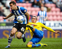 Tom Ince of Derby County challenges Jason Pearce of Wigan Athletic  - Photo mandatory by-line: Matt McNulty/JMP - Mobile: 07966 386802 - 06/04/2015 - SPORT - Football - Wigan - DW Stadium - Wigan Athletic v Derby County - SkyBet Championship