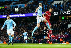 Oleksandr Zinchenko of Manchester City and Bobby Reid of Bristol City compete for the ball - Rogan/JMP - 09/01/2018 - Etihad Stadium - Manchester, England - Manchester City v Bristol City - Carabao Cup Semi Final First Leg.