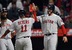 April 18, 2018 - Anaheim, CA, U.S. - ANAHEIM, CA - APRIL 18: Boston Red Sox left fielder J.D. Martinez (28) high fives third baseman Rafael Devers (11) at home plate after Devers hit a grand slam in the third inning of a game against the Los Angeles Angels of Anaheim played on April 18, 2018 at Angel Stadium of Anaheim in Anaheim, CA. (Photo by John Cordes/Icon Sportswire) (Credit Image: © John Cordes/Icon SMI via ZUMA Press)