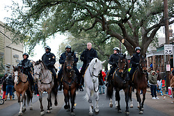 04 March 2014. New Orleans, Louisiana.<br /> Mayor Mitch Landrieu rides a horse ahead of the early morning Krewe of Zulu parade.<br /> Photo; Charlie Varley/varleypix.com