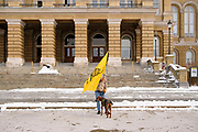 "02 JANUARY 2021 - DES MOINES, IOWA: A man with a Gadsden Flag at the Iowa State Capitol. About 30 people marched around the Iowa State Capitol Saturday afternoon to protest the outcome of the November 3 general election in the United States. They are a part of the ""Stop the Steal"" movement which maintains that the election was stolen from Donald Trump by massive voter fraud. There is no evidence supporting their conspiracy theory. This is the 9th week Donald Trump supporters have marched around the Capitol. They've been there every week since the Nov. 3 election. More than 1,000 people showed up the first week, but the crowd has gotten smaller every week.    PHOTO BY JACK KURTZ"