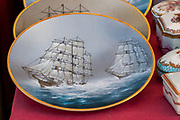 A Portuguese souvenir Illustration of two tall ships with full sail sailing in a rough sea