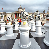 London September 18  Chess pieces from an art installation entitled 'The Tournament at Trafalgar Square' are pictured in central London, on September 18, 2009. The Tournament is art an installation made up of 2 metre high ceramic chess pieces on a glass mosaic chess board. Many of the illustrations on the chess pieces reference iconic buildings in London. Members of the public are invited to take part in the game. The installation was designed by Spanish designer Jaime Hayon. ...***Standard Licence  Fee's Apply To All Image Use***.Marco Secchi /Xianpix. tel +44 (0) 771 7298571. e-mail ms@msecchi.com.www.marcosecchi.com
