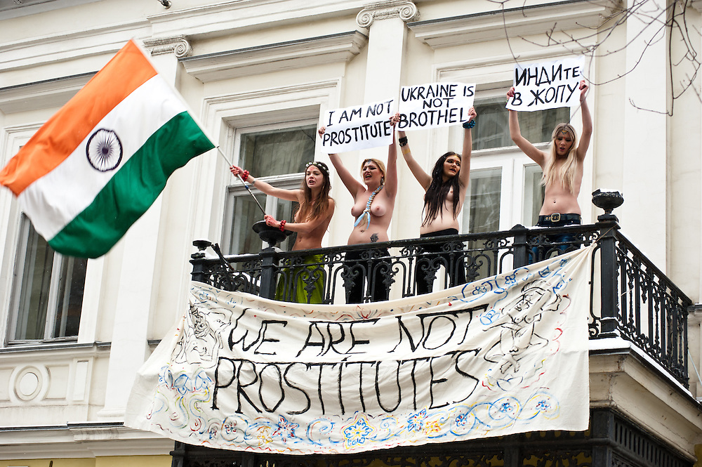 """Kiev, January 18, 2012: four FEMEN activists occupied the balcony residence of the Ambassador of India in Ukraine. Activists unfurled a banner on the balcony """"We're not prostitutes,"""" shouting """"Delhi, close their brothels,"""" """"The Ukrainians are not prostitutes!"""" and """"We demand an apology."""" The four activists were arrested and taken to the police station.<br /> <br /> The action was directed against the official policy of the Foreign Ministry of India, urging their ambassady in the CIS countries be scanned women aged 15 to 40 years, traveling to India. Thus, the official Delhi wants to insulate itself from the invasion of post-Soviet women, allegedly responsible for the rapid development of India's sex industry. Oksana Shachko (R)"""