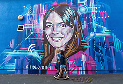 Edinburgh Science Festival, Edinburgh, Scotland, United Kingdom: <br /> Pictured: Valentina Maia, aged 6 years, and Edie Lamont, aged 7 years, admire the portrait by graffiti and mural artist Shona Hardie of  Natalie Duffield, one of the artworks in a street art trail called 'Women in STEM' which showcases the achievements of nine women who have contributed to the world of Science, Technology, Engineering and Maths (STEM). Natalie Duffield is CEO of InTechnology SmartCitie, a company that provides free WiFi in central Edinburgh. Shona has also painted many of the other portraits in the trail which are displayed in venues across the city. <br /> The 2021 Edinburgh Science Festival runs from 26 June – 11 July.<br /> Sally Anderson   EdinburghElitemedia.co.uk