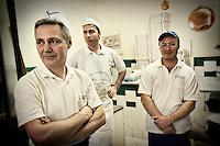 Pizza chefs in the kitchen of Antica Pizzeria de Michele, Naples, Italy.