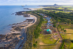 Aerial view of large modern luxury house built beside Firth of Forth at Archerfield Estate in East Lothian , Scotland, UK