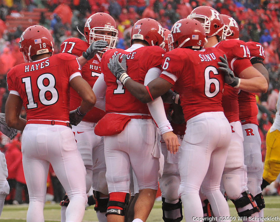 Dec 5, 2009; Piscataway, NJ, USA; Rutgers quarterback Tom Savage (7) celebrates his two-point conversion rush with his teammates during second half NCAA Big East college football action in West Virginia's 24-21 victory over Rutgers at Rutgers Stadium.
