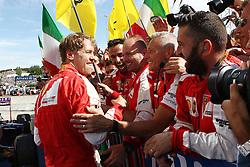 26.07.2015, Hungaroring, Budapest, HUN, FIA, Formel 1, Grand Prix von Ungarn, Rennen, im Bild Sebastian Vettel (Scuderia Ferrari) jubelt mit seinen Mechanikern nach dem Sieg // during the race of the Hungarian Formula One Grand Prix at the Hungaroring in Budapest, Hungary on 2015/07/26. EXPA Pictures © 2015, PhotoCredit: EXPA/ Eibner-Pressefoto/ Bermel<br /> <br /> *****ATTENTION - OUT of GER*****