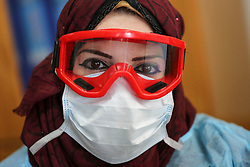 March 18, 2020, Gaza City, Gaza Strip, Palestinian Territory: Employees from the United Nations Relief and Works Agency (UNRWA) for Refugees wearing a protective facemasks receive respiratory patients at some UNRWA schools, in gaza city, on March 18, 2020. As preperations are underway to receive, examine and isolate potential victims of the Covid-19 coronavirus  (Credit Image: © Ashraf Amra/APA Images via ZUMA Wire)