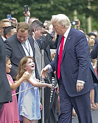 June 16, 2017 - Washington, District of Columbia, United States of America - United States President Donald J. Trump and guests as he arrives at the White House in Washington, DC following a trip from Miami, Florida on Friday, June 16, 2017.  In Miami, the President gave remarks and participated in a signing on the United States' policy towards Cuba..Credit: Ron Sachs / CNP (Credit Image: © Ron Sachs/CNP via ZUMA Wire)