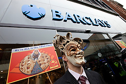 © under license to London News Pictures. 19/02/2011: UKUncut protesters on Market Street in Manchester City Centre force the closure of Barclays Bank. Protesters say that Barclays Bank pays large bonuses whilst legally avoiding a large percentage of tax.