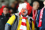 A Lincoln City fan  celebrates.  The Emirates FA cup 5th round match, Burnley v Lincoln City at Turf Moor in Burnley, Lancs on Saturday 18th February 2017.<br /> pic by Chris Stading, Andrew Orchard Sports Photography.
