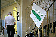 A prison guard walks past a  sign to the prison mosque inside Wandsworth prison..HMP Wandsworth in South West London was built in 1851 and is one of the largest prisons in Western Europe. It has a capacity of 1456 prisoners.