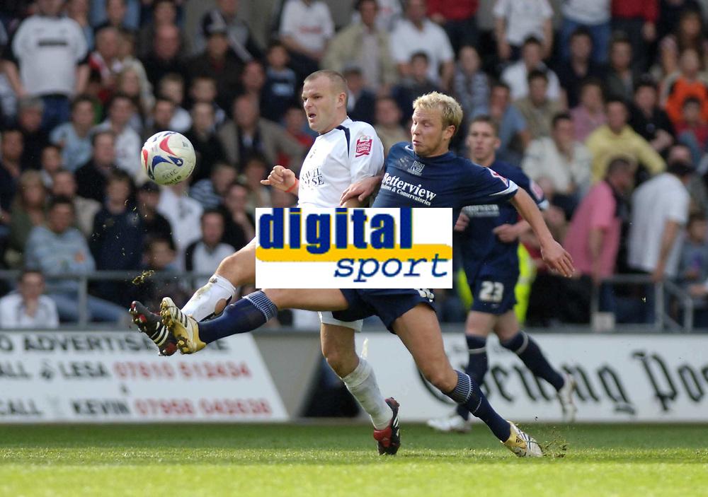 Photo: Adam Davies.<br />Swansea City v Southend United. Coca Cola League 1. <br />29/04/2006.<br />Southend's Luke Guttridge and Swansea's Andy <br />Robinson.