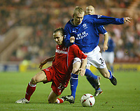 Photo. Andrew Unwin.<br /> Middlesbrough v Everton, Carling Cup Fourth Round, Riverside Stadium, Middlesbrough 03/12/2003.<br /> Middlesbrough's Bolo Zenden (l) falls under the challenge of Everton's Tony Hibbert (r).