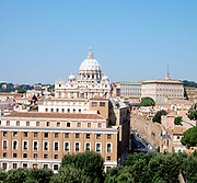 Distant shot of St. Peter's Basilica in the Vatican City, Italy. The church is the most renowned work of Renaissance architecture, and was designed by Donato Bramante, Michelangelo, Carlo Maderno and Gian Lorenzo Bernini. The original basilica is from 4th century AD, but the current design was completed in 1626.