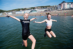 © London News Pictures. 15/08/2016. Aberystwyth .UK.<br /> Teenagers of their long summer holidays having fun jumping off the seaside jetty into the cool clear sea  in Aberystwyth on the west wales Coast. The weather is set to improve over the next two days, culminating in a mini-heatwave on Wednesday, with temperatures forecast to reach the high 20s or low 30s centigrade. Photo credit: Keith Morris/LNP