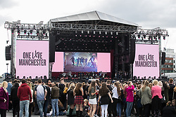 © Licensed to London News Pictures .  04/06/2017 . Manchester , UK . Fans congregate in front of the stage 2 hours ahead of the gig. The One Love Manchester benefit concert for victims of the Manchester Arena terrorist attack , at the Emirates Old Trafford Cricket Stadium . Ariana Grande, Justin Bieber, Coldplay, Katy Perry, Miley Cyrus, Pharrell Williams, Usher, Take That, Robbie Williams, Black Eyed Peas and Niall Horan are amongst the performers. Photo credit : Joel Goodman/LNP