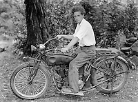 Man on motorcycle - possibly an Indian - 1920's