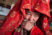 Ikhbal (15 years old) crying, because she will soon live her family to move to her husband's house..The veil celebration: before moving to her new husband's camp, Ikhbal, a recently married Kyrgyz girl, will exchange the red veil of the unmarried girl for the white veil signifying that she is now a married woman...The Kyrgyz settlement of Ech Keli, above Chaqmaqtin lake, Er Ali Boi's camp...Trekking through the high altitude plateau of the Little Pamir mountains, where the Afghan Kyrgyz community live all year, on the borders of China, Tajikistan and Pakistan.