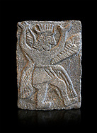 Hittite relief sculpted orthostat panel od a god from Tell Halaf, ancient Guzana, Syria, iX cent BC, Louvre Museum. Cat No AO 11073 . Black background