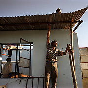 Workers build a de-salination tank after the tsunami washed out swathes of arable fields in Nagappattinam, on the southeastern coast of India..The December 26, 2004 tsunami killed thousands of people along this coast, smashing boats, roads and houses and tearing thousands of families apart. .Picture taken February 2005 in Nagapptinam, Tamil Nadu, India, by Justin Jin