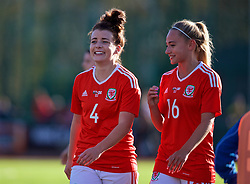 YSTRAD MYNACH, WALES - Wednesday, April 5, 2017: Wales' Angharad James (L) and Charlie Estcourt (R) walk off the pitch after the 3-1 win in the Women's International Friendly match against Northern Ireland at Ystrad Mynach. (Pic by Laura Malkin/Propaganda)