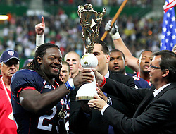 16.07.2011, Ernst Happel Stadion, Wien, AUT, American Football WM 2011, United States of America (USA) vs Canada (CAN), im Bild Tommy Wiking (IFAF President) and Norbert Darbos (Sport and Ministery of Defense Austria) hands the trophy over to Osayi Osunde (USA, #23, LB)  // during the American Football World Championship 2011 game, USA vs Canada, at Ernst Happel Stadion, Wien, 2011-07-16, EXPA Pictures © 2011, PhotoCredit: EXPA/ T. Haumer