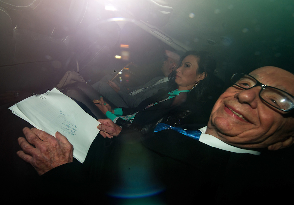 Rupert Murdoch with wife Wendi Deng  and son Lachlan Murdoch leaving the Murdoch home in central London ahead of giving evidence today at The Leveson Inquiry on April 25th 2012...Photo Ki Price.