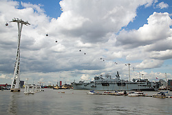 © Licensed to London News Pictures. 15/04/2014. The Royal Navy's biggest warship HMS Ocean sailed in to London today. The Might O as she is nicknamed arrived in London on a sunny day on the same day as the UK General Election. Her visit is timed to coincide with the anniversary of VE Day and events will take place on board this weekend. She will be moored at Greenwich until Monday. Credit : Rob Powell/LNP