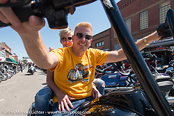Paul and Suzy Yaffe ride down Main Street during the Annual Sturgis Black Hills Motorcycle Rally.  SD, USA.  August 7, 2016.  Photography ©2016 Michael Lichter.