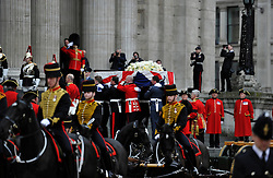 © Licensed to London News Pictures. 17 April 2013. St Paul's Cathedral London. Coffin is carried up the steps of St Paul's by the military pall bearers. Funeral of Baroness Thatcher, former Conservative Prime Minister. Photo credit : MarkHemsworth/LNP