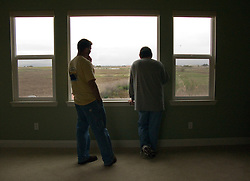 Homeowners pause during moving in their now empty  master bedroom in Vallejo, Calif.  They  lost their home in 2009 to foreclosure due to a combination of job loss, adjustable loan payments doubling and  home value under water nearly fifty percent. Photo by Kim Kulish