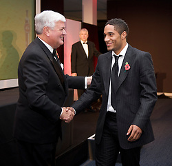 CARDIFF, WALES - Wednesday, November 11, 2009: Wales' Ashley Williams is congratulated by General Secretary David Collins during the Football Association of Wales Player of the Year Awards hosted by Brains SA at the Cardiff City Stadium. (Pic by David Rawcliffe/Propaganda)