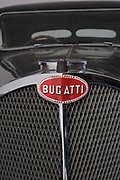 Found in a garage where it had been stored virtually untouched for 50 years, this 1937 Bugatti Type 57s Atalante sports car is previewed for the first time before a Bonhams auction in Paris on February 7th 2009. Here, we see a detail of its radiator grill in a garage/studio before the auction and sale in Paris. In 2008 the Bugatti Type 57S with chassis number 57502 built in 1937 with the Atalante coachwork for Earl Howe was discovered in a private garage in Newcastle upon Tyne, having been stored untouched for 48 years and known about only by a select few people. It was auctioned in February 2009 at the Retromobile motor show in Paris, France, fetching €3.4 million (US$4.6 million), becoming one of the highest valued cars in automotive history, owing much to its extremely low mileage, original condition and ownership pedigree.