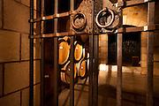 Wine barrels in locked wine cellar