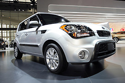 "08  February 2013: 2013 Kia Soul automobile. Chicago Auto Show, Chicago Automobile Trade Association (CATA), McCormick Place, Chicago Illinois<br /> <br /> 2013 Kia Soul: Kia's Soul compact crossover is one of the brand's best-selling vehicles. For 2013, Soul continues with funky ""outside of the box"" styling, offered in Soul, Soul+ and Soul ! trim levels. Subtle changes include revised Kia badges, dark chrome accents, and exterior paint colors, including Clear White, Dune, Alien green, red-hot Molten, Shadow and Moss. Overall shape of the five-door hatchback has a smoother and more streamlined silhouette, and projects a wider stance. New projector headlights, LED taillights and restyled wheels add a more modern look. All 2013 Soul models amplify the fun-to-drive factor by delivering a class-leading 164 horsepower from the 2.0-liter engine, and 138 hp with the 1.6L. Both are four-cylinders and are available with a choice of the efficient six-speed manual or six-speed automatic transmissions. Soul offers the fuel saving Idle Stop and Go (ISG) technology, that turns off the engine when the vehicle is not in motion and restarts automatically when the driver releases the brake pedal. Inside the five-passenger cabin, available infotainment features include UVO powered by Microsoft voice-activated system, a 4.3-inch color touch screen and rear camera, upgraded leather on the leather-wrapped steering wheel, standard Bluetooth wireless technology with steering wheel-mounted controls. When rear seat are down, the Soul can haul up to 53.4 cu. ft. of cargo."