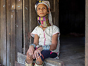 Portrait of a Kayan Padaung ethnic minority woman on 23rd January 2016 in Kayah State, Myanmar. Myanmar is one of the most ethnically diverse countries in Southeast Asia with 135 different indigenous ethnic groups. There are over a dozen ethnic Karenni subgroups in the region including the Kayan who are perhaps the best known due to the traditional practice of the Kayan women extending their necks with brass rings
