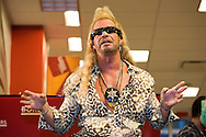 """Duane """"Dog The Bounty Hunter"""" Chapman signing his book """"You Can Run But You Can't Hide"""". .Borders bookstore in Hollywood, CA. His wife Beth was also there..Mexican officials dropped all charges connected with the """"Dogs'"""" capture of fugitive murderer Andrew Luster who fled to Mexico."""