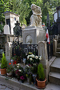 "The celebrated tomb of Polish-born composer Frédéric François Chopin in the Pere Lachaise cemetery, Paris. Chopin was a Polish composer and virtuoso pianist of French-Polish parentage. He is considered one of the great masters of Romantic music. Chopin was born in Żelazowa Wola, a village in the Duchy of Warsaw. A renowned child-prodigy pianist and composer, Chopin grew up in Warsaw and completed his music education there; he composed many mature works in Warsaw before leaving Poland in 1830 at age 20. Père Lachaise Cemetery (French: Cimetière du Père-Lachaise- or officially cimetière de l'Est, ""East Cemetery"") is the largest cemetery in the city of Paris, France (44 hectares (110 acres) containing the remains of a million French and foreign dead."